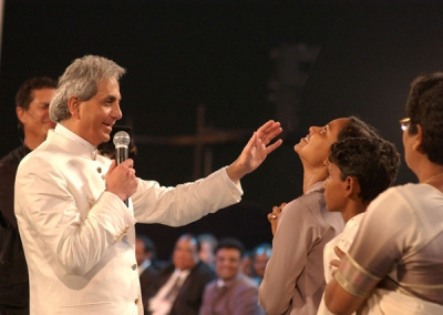This is Benny Hinn, a famous TV evangelist. Some people think he's basically the new Jesus. He apparently makes people fall over when he saves them and stuff. He also had an affair with some other preacher and bought a private jet with all the money people give him...allegedly. I think Benny and rodeo MC guy are best friends.